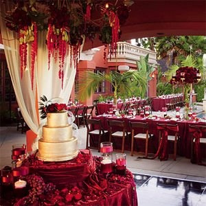 Red Decorations and Cake Table – shared on 9WeddingWebsites