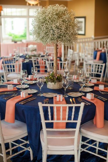 Navy and Coral Tablescape with Baby's Breath – shared on Wedding Colors