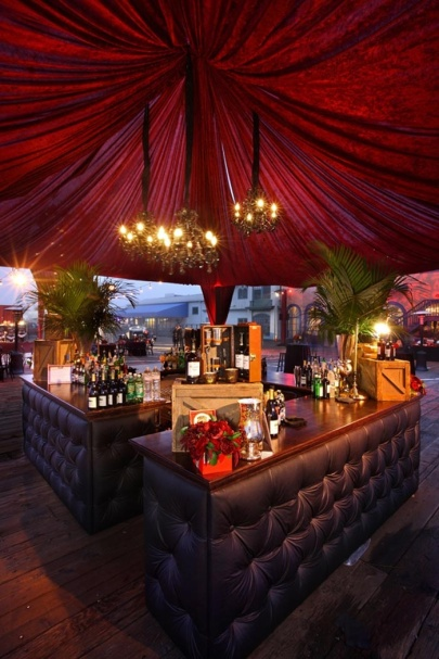 Dramatic Red Velvet Draped Central Bar – shared by BizBash