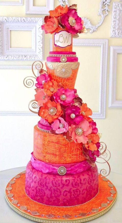 Pink and Orange Tiered Wedding Cake – shared by ModWedding