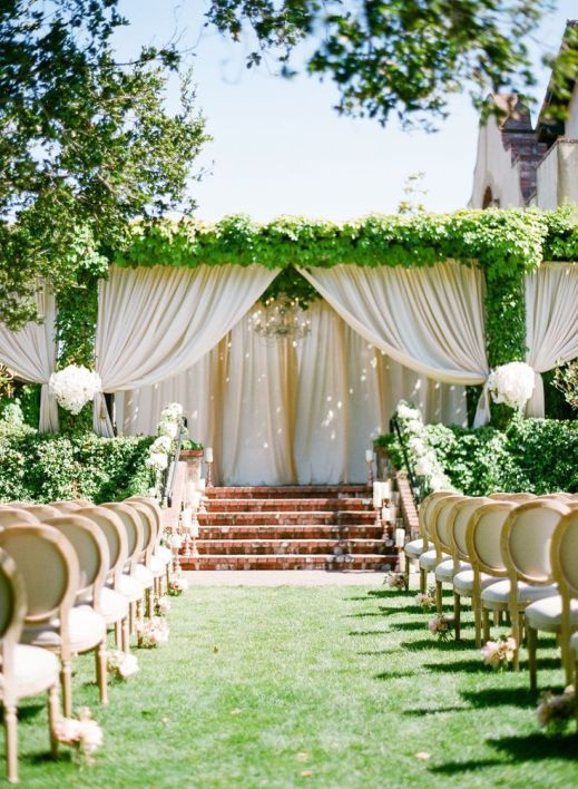 Dreamy Draped Wedding Alter with Greenery Accents – shared on Style Me Pretty