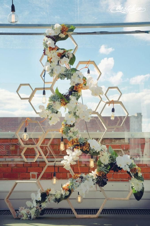Honeycomb Wedding Ceremony Backdrop – shared in a roundup post on Royal Lace Bridal