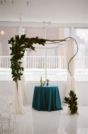 Modern Magnolia and Linen Wedding Alter – shared on Style Me Pretty