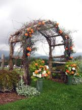 Orange Country Garden Wedding Arbor – shared in a roundup post on Rustic Wedding Chic