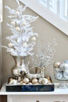 Modern White and Gold Winter Ornament Display – spotted on Pinterest