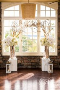 White Birch Branched Wedding Arch – shared in a roundup post on Flirty Fleurs