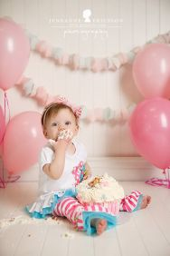 Soft Pink and White Birthday Cake Smash Set Up – shared on Jeneanne Ericsson