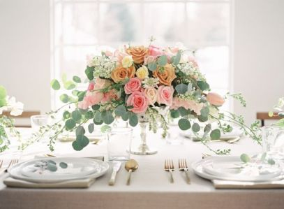 Blush, Peach, and Emerald Wedding Centerpiece – shared on Wedding Sparrow