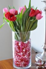 Candy and Tulips Table Centerpiece – shared in a roundup post by Designer Trapped in a Lawyer's Body