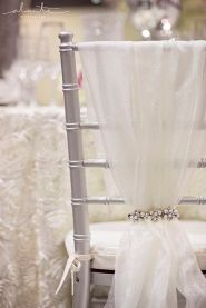 Sparkly Tulle and Pearl Chair Décor – shared in a roundup post on Want That Wedding