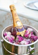Champagne Bottle Display with Frozen Flowers in Ice – shared in a round up post on OMG Lifestyle Blog