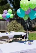 Green, Blue, and Purple Polka Dot Balloons with Dinosaur Weights as Table Décor – shared by Craftiness is not Optional