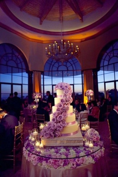 purple rose wedding cake on flower tablescape shared by colin cowie weddings