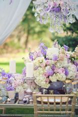 White and Lilac Purple Rustic Centerpiece with Fresh Flowers and Candles – shared on WedLuxe