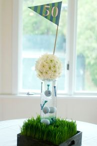 Golf Themed Centerpiece with Grass, Balls, Tees, and Flowers – shared on Pinterest