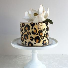 Leopard Print Cake with White Flower – spotted on Pinterest