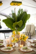 Tropical Tall Centerpiece with Palm Leaves with Yellow Flowers – shared by Elizabeth Anne