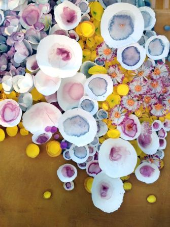 Abstract Watercolor Paper Flowers on a Gold Backdrop Photo Booth Wall – shared in a roundup post by Engaged and Inspired
