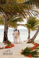 Beach Wedding Aisle with Palm Leaves and Vibrant Flowers – shared by Olivera Rusu Photography