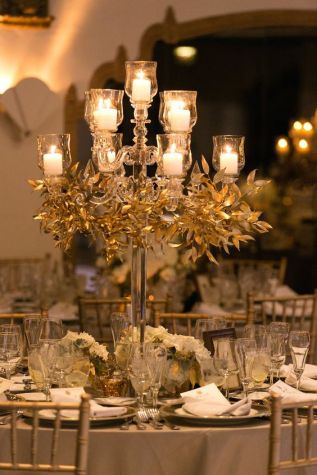 Crystal Candelabra with Gold Leaf Garland Centerpiece – shared by MODwedding