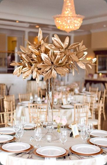 Golden branch and leaves centerpiece shared by the