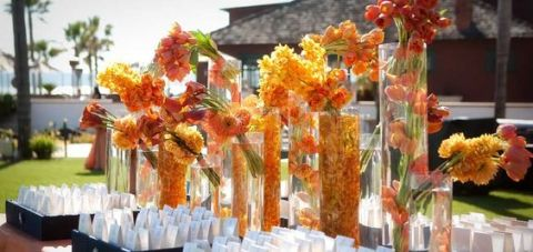 Submerged and Clustered Tropical Orange Flower Arrangements on Escort Table – shared by Karen Tran Florals