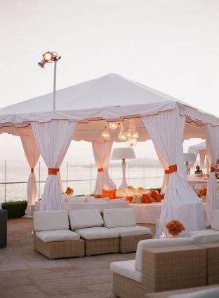 Clean White with Pops of Orange Cabana and Party Lounge – shared on Style Me Pretty
