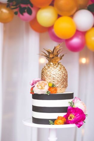 Colorful Tiered Cake with Black and White Stripes and a Golden Pineapple – shared by MidwestBride