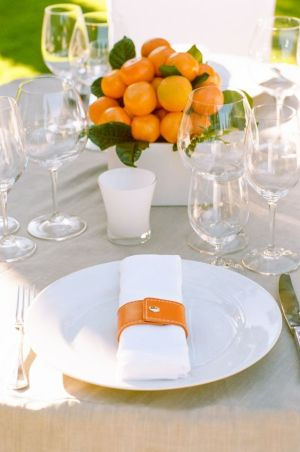 Modern Orange and White Tablescape with Orange Citrus Fruit