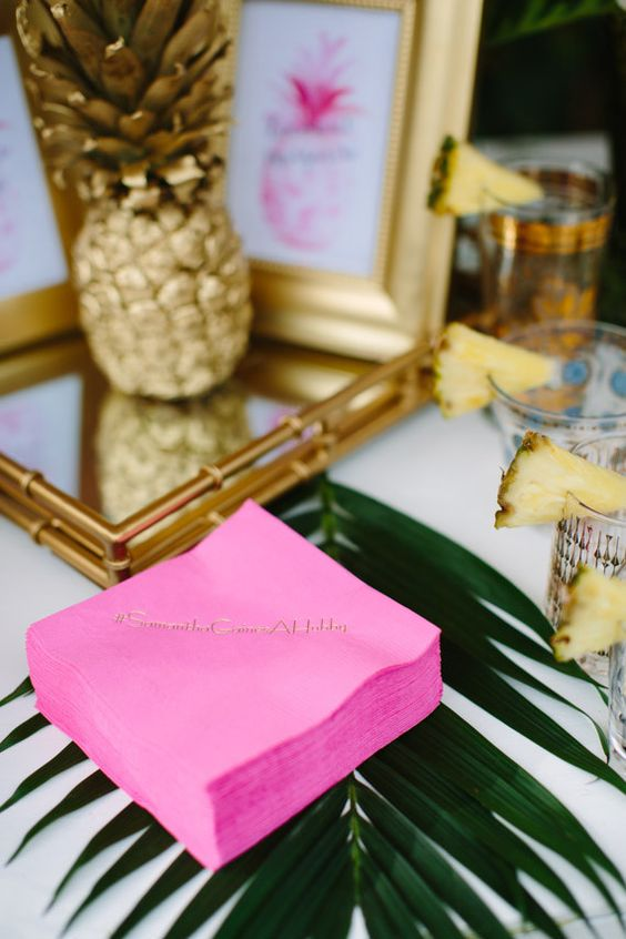 Party Table with Hot Pink Napkins, Palm Leaves, and a Golden Pineapple - shared on 100 Layer Cake