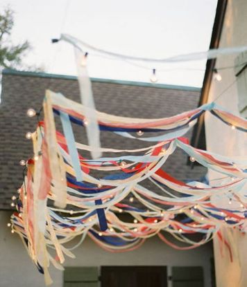 Red, White, and Blue Patriotic Ribbon Garlands with Market Lights – shared in a roundup post on Babble