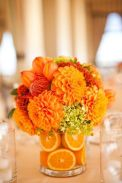 Vibrant Orange Flower Centerpiece with Orange Slices