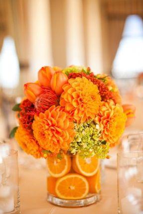 Vibrant Orange Flower Centerpiece with Orange Slices