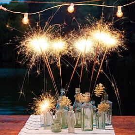 Sparkler Centerpieces with Eclectic Vases – shared by Southern Living