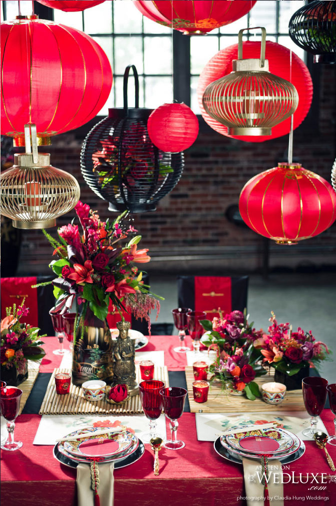 Asian Inspired Tablescape with Red and Gold Paper Lanterns Hanging from Above – shared on WedLuxe