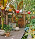 Backyard Tropical Patio with Hanging Lanterns and Banana Trees – shared on Traditional Home