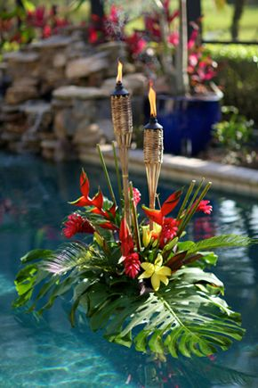 Floating Pool Décor with Tropical Foliage and Tiki Torches – featured on Jet Fete