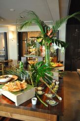 Green Tropical Palm Leaves and Wood Food Buffet and Display
