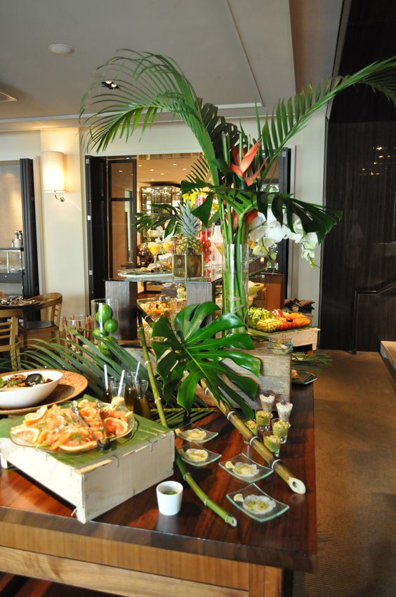 Green Tropical Palm Leaves And Wood Food Buffet And