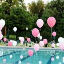 Pink Floating Balloons Pool Décor – shared in a roundup post by How Does She