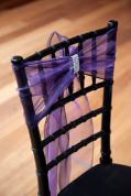 Black Chivari Chair with Purple Ribbon and Rhinestone Accent – found in the Style Me Pretty Vault