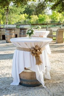 Cocktail Hour Tables of Wine Barrels – shared on Wedding Wire
