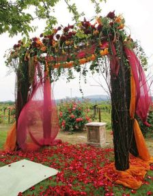 Plum and Burnt Orange Ceremony Vine Covered Altar and Mandap Overlooking Vineyard