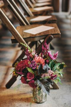 Plum Wedding Aisle Décor Flower Arrangements – shared on Ruffled