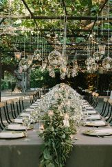 Tablescape of Floating Candles in Glass Bubbles Under Vines – shared by wedsource on Etsy
