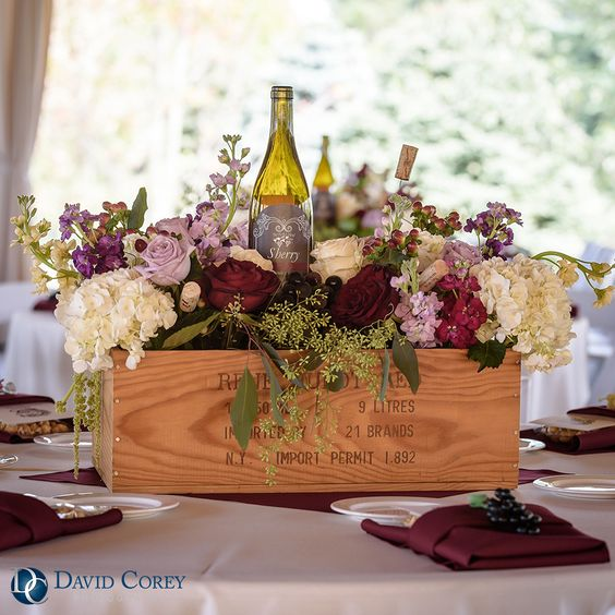 Vineyard inspired wine bottle centerpiece shared on for Wedding table decorations with wine bottles