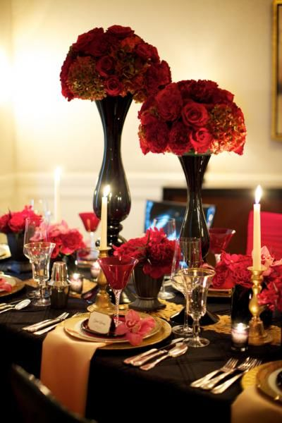 Black and Red Centerpieces with Gold Accents – shared in a roundup post by Destination Wedding Mag