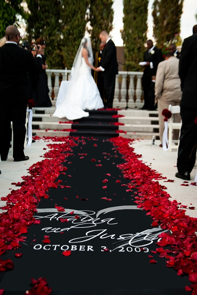 black and red wedding aisle runner shared in a roundup post by