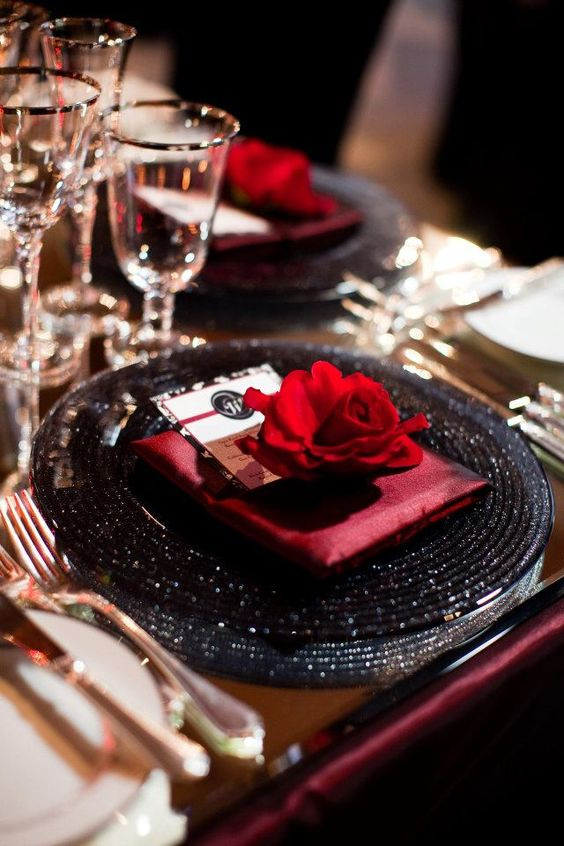 Black Glitter Charger with Red Rose and Napkin Accent Place Setting