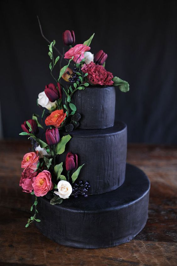 Black Tiered Cake with Flower Accents – featured on 100 Layer Cake